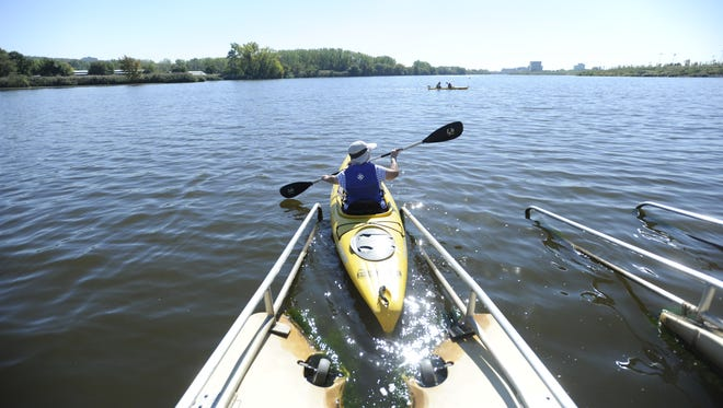 A kayaker launches her rental into Overpeck Creek in Overpeck County Park, Leonia.