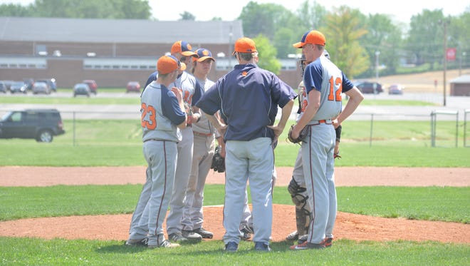 Galion assistant coach Dan Gorbett talks to pitcher Mac Spears and the infield during the team's district semifinal game against Margaretta.