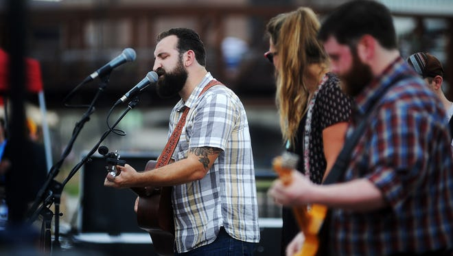Thomas Hentges, of Burlap Wolf King, performs on the Great Western Bank Amphitheater Main Stage during the second annual Downtown Riverfest on Saturday, Aug. 16, 2014, at the Downtown River Greenway along the Big Sioux River in Sioux Falls, S.D.