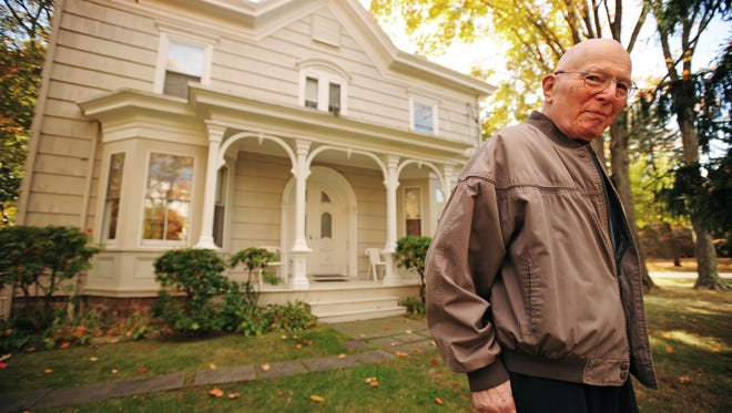 Charles Kaufman poses by his 150-year-old house he moved into in 1963, on Thursday October 24. He spent 50 years investigating the hidden treasures of his house and discovered few historical artifacts. MARKO GEORGIEV/STAFF PHOTOGRAPHER