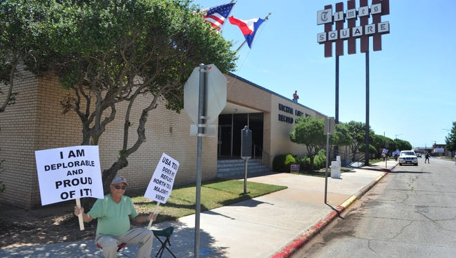 Jim Potts and a small group of others with America First protest in front of the Wichita Falls Times Record News Thursday. The group was protesting a perceived media bias against Trump.