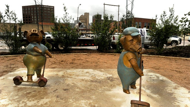 """Two of the """"Three Little Pigs"""" sculptures have been installed the final sculpture is set to be installed on Monday."""