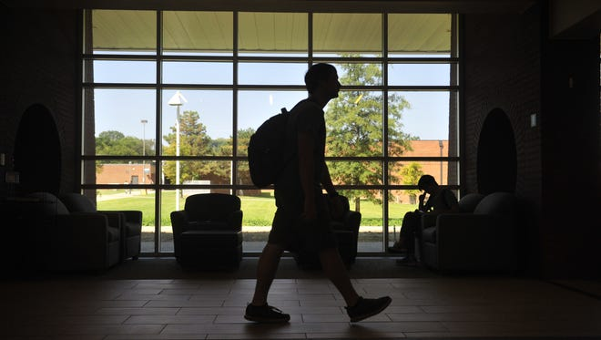 Students walk around campus on the first day of school on the Nashville State campus Aug. 24, 2015. Tennessee higher education officials are trying to keep tuition hikes low this year and into the future.