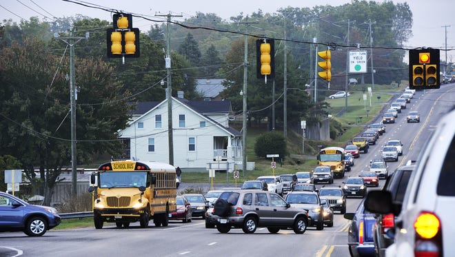 FILE/The News Leader r The stoplight wait is long when turning into the Wilson Memorial school complex. The stoplight wait is long, turning into the Wilson Memorial school complex. Katie Currid/The News LeaderSchool buses and vehicles wait at the stoplight to turn into the Wilson Memorial school complex on Thursday, Sept. 26, 2013 in Fishersville. With the addition of 100 children to Wilson Elementary School, traffic problems at the school complex has become congested.