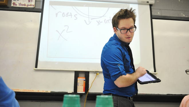 In this file photo, Chris Collins teaches during first period at Overton High School in Nashville, Tenn. April 22, 2015.