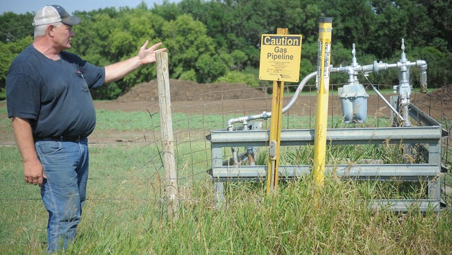 Mike Grace of Hartford talks about the farm tap that provides natural gas for his 4,000-acre operation. A dispute between Northern Natural Gas and NorthWestern Public Service threatens to force landowners to service their own farm tap lines or convert to propane.
