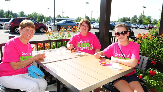 Canton residents Alice Power, daughter Kim Ives and granddaughter Allison Ives enjoy dinner during the Canton Grub Crawl at JB's Smokehouse.