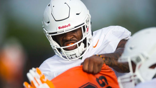 Tennessee's running back John Kelly (4) helps run a drill at a University of Tennessee fall football practice at Anderson Training Facility in Knoxville, Tenn. on Tuesday, Aug. 1, 2017.