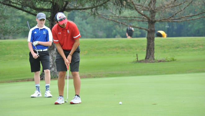Dalton Sheaffer putts on the green of the fifth hole Friday afternoon at Millstone Hills Golf Club.