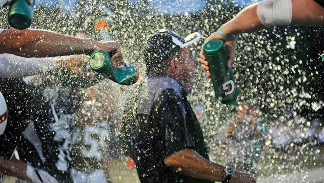 Vermont coach Bob Lockerby gets doused after Vermont's 19-0 win over New Hampshire at the 64th annual Shrine Maple Sugar Bowl at Castleton University's Spartan Stadium on Saturday, Aug. 5, 2017. (Photo by Michael Beniash/Caledonian Record)