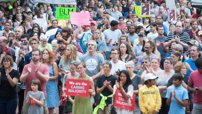 Rallygoers fill the Diag during a rally on the campus of the University of Michigan in Ann Arbor, Mich. on Sunday, Aug. 13, 2017.