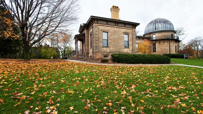 Golden leaves cover the ground in front of the renovated Washburn Observatory at the University of Wisconsin-Madison.