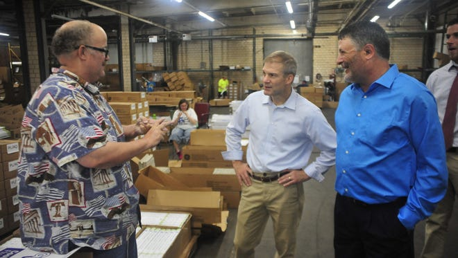 Jeff Turner, left, of Waycraft Industries, tells US Rep. Jim Jordan, center, and Vince Ponziani, executive director of Waycraft, a little about the company.