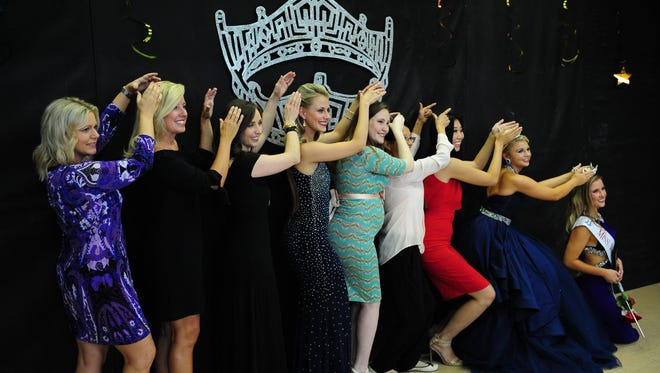 "Previous winners of Miss Wayne County do a ""Crowning Pose"" with the new winner, Hannah Dell (far right), crowned last week in Redford."