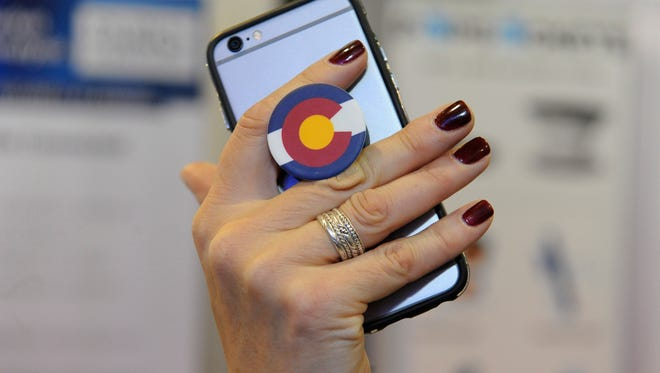 This is a PopSocket, an expanding grip and stand for your phone or tablet.