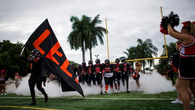 The Lely High School football team before a game against Gulf Coast High School at Lely High School on Friday, August 25, 2017. Gulf Coast High School won 27-2.