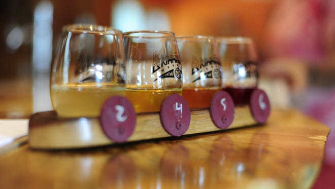 A flight of tasters at the Brimming Horn Meadery. The flight board is shaped like a viking ship, with chalk-painted shields for servers to use to identify different meads.