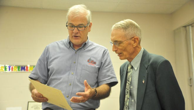 Bucyrus Mayor Jeff Reser, left, read retiring Crawford County Treasurer Gary Cole a proclamation thanking him for his service.