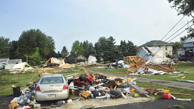 The contents of a garage remain in place after the structure was blown away in North Robinson.