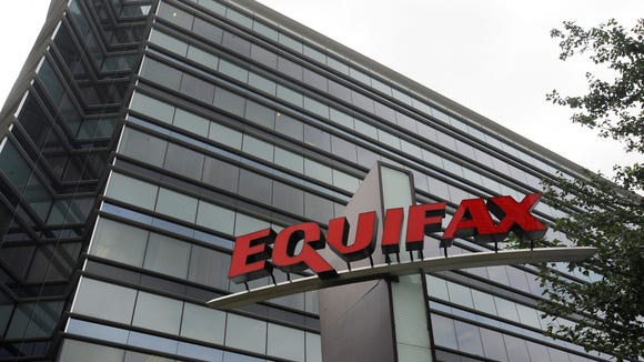 "This July 21, 2012, photo shows Equifax Inc., offices in Atlanta. Credit monitoring company Equifax says a breach exposed social security numbers and other data from about 143 million Americans. The Atlanta-based company said Thursday, Sept. 7, 2017, that ""criminals"" exploited a U.S. website application to access files between mid-May and July of this year."