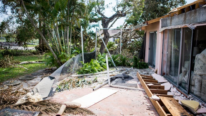 A lanai and roof in East Naples, seen on Thursday, Sept. 14, 2017, were among many destroyed by Hurricane Irma.