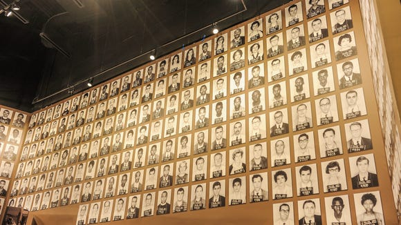 An exhibit at the Mississippi Civil Rights Museum displays the photos of Freedom Riders who were arrested in Jackson, Mississippi, on May 24, 1961.