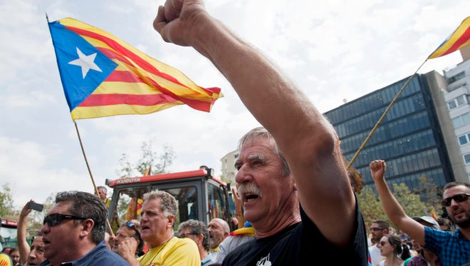 Some 500 people gather during a march called by Agrarian Unions to support the celebration of the independence upcoming referendum on Oct. 1, 2017,  in Girona, Catalonia, northeastern Spain, Sept. 29, 2017.