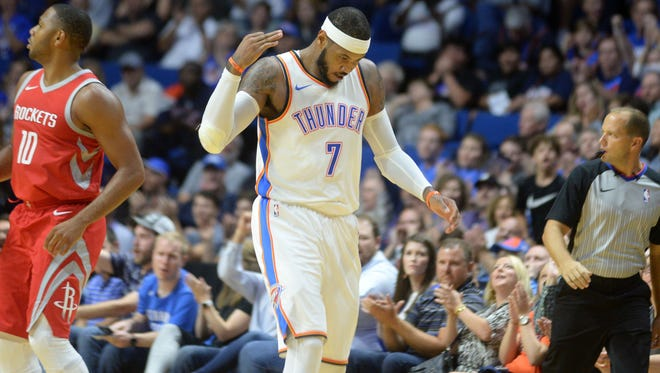 Oklahoma City Thunder forward Carmelo Anthony (7) reacts after hitting a three point shot against the Houston Rockets during the second quarter at the BOK Center.