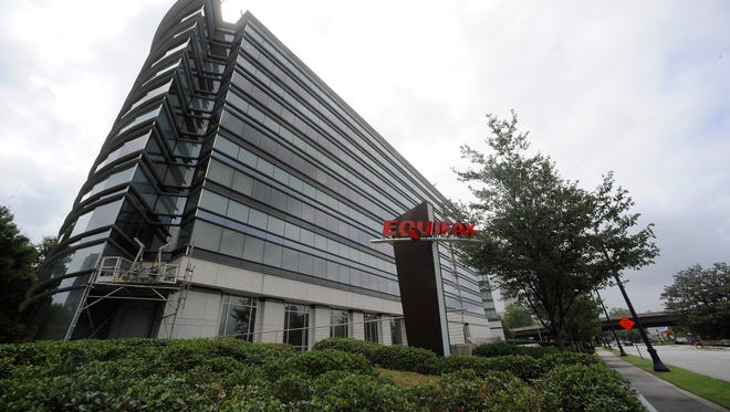 FILE - This Saturday, July 21, 2012, file photo shows the corporate headquarters of Equifax Inc. in Atlanta. Equifax knows a lot about you. That, in essence, is how it makes money. The company and its competitors, Experian and TransUnion, make most of their money selling bulk lists to banks and credit card companies. (AP Photo/Mike Stewart, File)