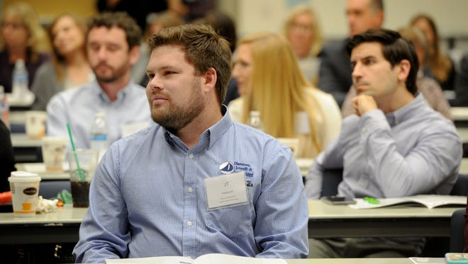 JT Katavich, with Hammer, Jewell & Associates, listens to a discussion during the 16th annual Ventura County Housing Conference last year.