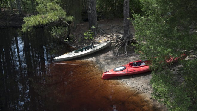 Kayaks rest at on the Tulpehocken Creek, a tributary of the Wading River, in Wharton State Forest in the New Jersey Pine Barrens.