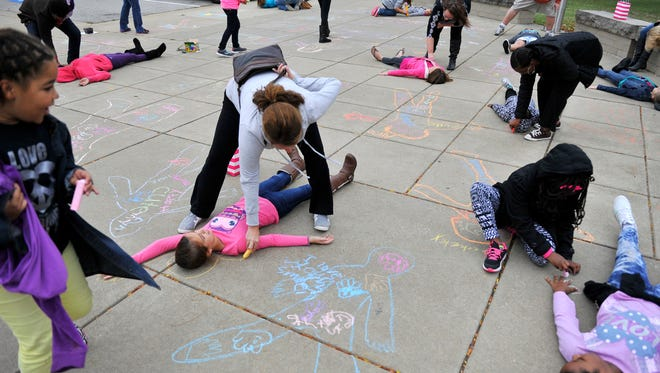Girls participate in a body-positive activity during Girls: Embrace Your Body.