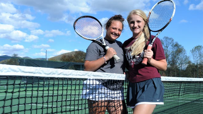 Owen seniors Ashley Valencia, left, and Jaiden Tweed get together to practice for the 2017 2-A Women's Individual Tennis State Championships Doubles Draw in Cary.