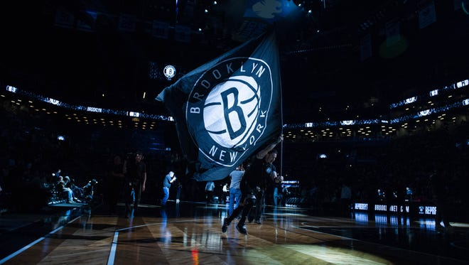 The Brooklyn Nets flag is run across the court in the first half at Barclays Center. Milwaukee defeats Brooklyn 109-100.