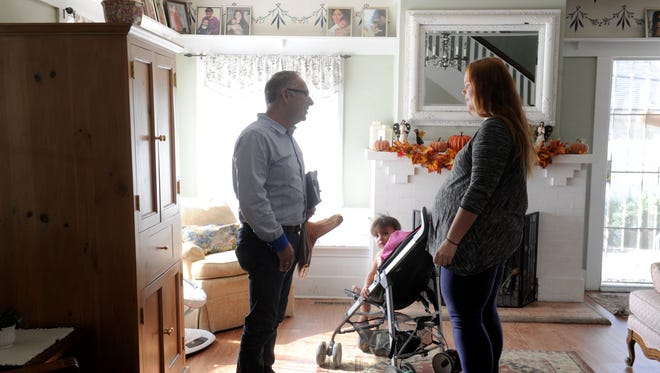 Jim Duran, left, executive director of Tender Life Maternity Home talks with Amanda Gracey, right, and her daughter Rylee Gracey, 1, at their office home. They offer housing to homeless pregnant women, who could stay there until baby is 3 months or so old.