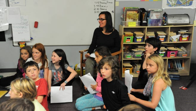 Lyn VanOver and her class at ArtSpace Charter School in Swannanoa rehearse for a play during class on Nov. 7.