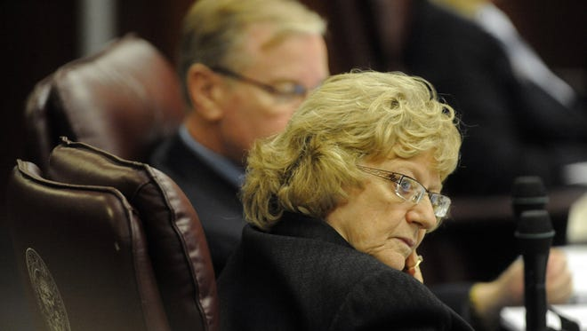 Senator Joyce Woodhouse listens as statements are made as the Senate passes the budget bill in the early morning hours of Monday, March 1, 2010.