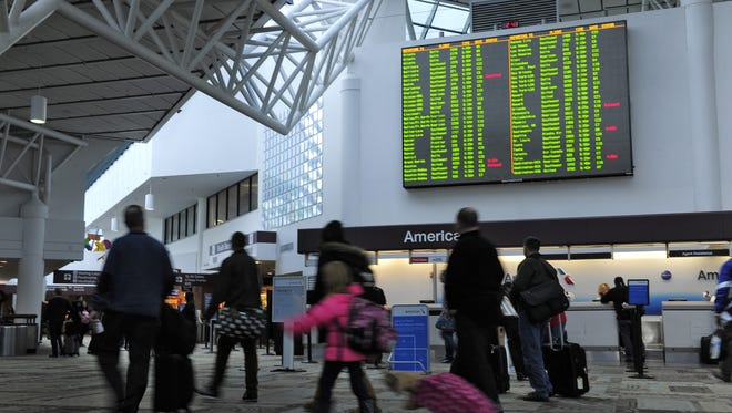 Travelers make their way through the Metro Nashville International Airport Friday Jan. 8, 2016, in Nashville, Tenn.
