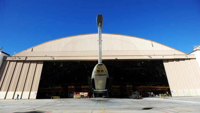 FILE - In this Oct. 30, 2014 file photo, the tail of a C5 Galaxy aircraft sticks out the door of Building 125 at Robins Air Force Base in Warner Robins, Ga.  Radio interference from a farm's massive metal crop-watering structure is causing havoc for air traffic in the sky over Georgia, federal authorities said in a lawsuit filed this week. The irrigation structure is on a south Georgia farm where the Federal Aviation Administration has a radio transmitter to relay signals that keep aircraft on course, according to the federal lawsuit.