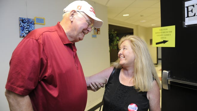 Williamson County Commissioner Judy Herbert is congratulated by Don Wade during Williamson County's primary election in 2014.