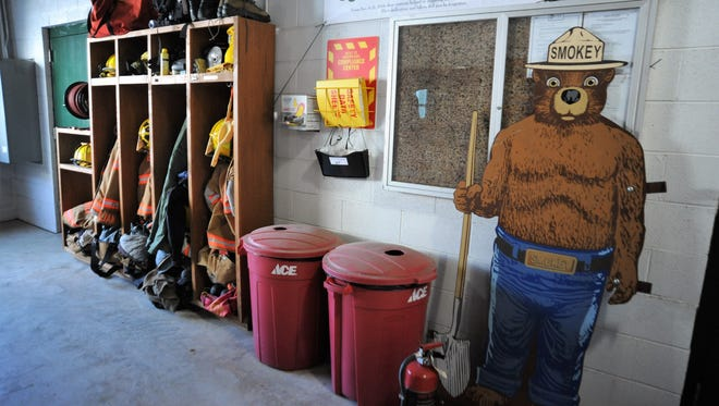 A 6-foot metal Smokey Bear sign sits near the lockers inside the Broad River Volunteer Fire and Rescue Department Jan. 4 days after it was taken and recovered nearby.