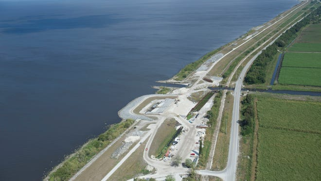 Construction on Herbert Hoover Dike Culvert 11 is seen on an aerial tour of South Florida Water Management District projects March 24, 2017, near Lake Okeechobee. Moving more water south of the lake and treating it could replenish the Everglades and Florida Bay with clean water.