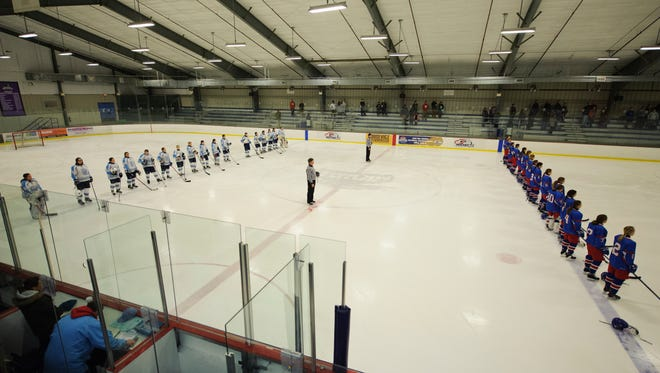 The teams listen to the national anthem during the girls hockey game between the Hartford Hurricanes and the South Burlington Wolves at Cairns on Saturday night February 3, 2018 in South Burlington.