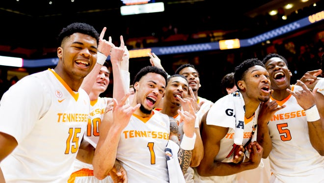 Tennessee players celebrate their win after defeating Ole Miss 94-61 at Thompson-Boling Arena in Knoxville, Tennessee on Saturday, February 3, 2018.