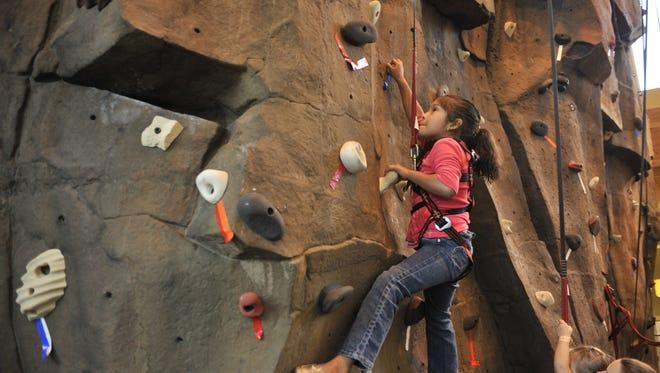 STATESMAN JOURNAL file Natalie Avila climbs the rock wall at the Kroc Center. Natalie Avila climbs the rock wall at the Kroc Center on Sept. 12, 2009.