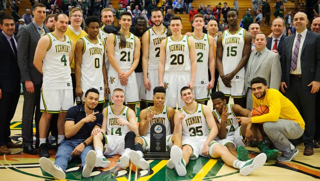 Vermont celebrates the America East regular season championship during the men's basketball game between the Binghamton Bearcats and the Vermont Catamounts at Patrick Gym on Wednesday night February 21, 2018 in Burlington.
