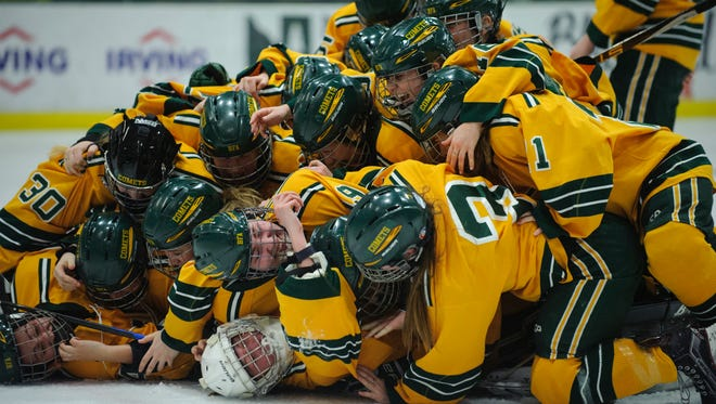BFA celebrates the championship during the Vermont state division I girls hockey championship game between the Essex Hornets and the BFA St. Albans Comets at Gutterson Field House on Monday night March 12, 2018 in Burlington.