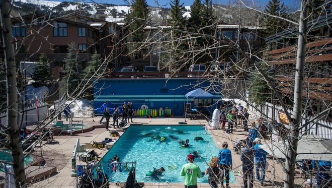 Veterans enjoy scuba diving on Monday, April 2, 2018, in Snowmass Village, Colo., for the National Disabled Veterans Winter Sports Clinic. (Anna Stonehouse/The Aspen Times via AP)