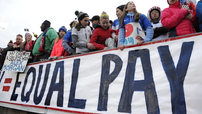 Jessica Hill/AP Fans stand behind a sign promoting equal pay for the women?s soccer team during a match April6 between the United States and Colombia in East Hartford, Conn. FILE - In this April 6, 2016, file photo, fans stand behind a large sign for equal pay for the women's soccer team during an international friendly soccer match between the United States and Colombia at Pratt & Whitney Stadium at Rentschler Field in East Hartford, Conn. The World Economic Forum's annual Global Gender Gap Report released on Oct. 25, 2016, found that the global gender pay gap will not be closed for another 170 years if current trends continue. (AP Photo/Jessica Hill, File)