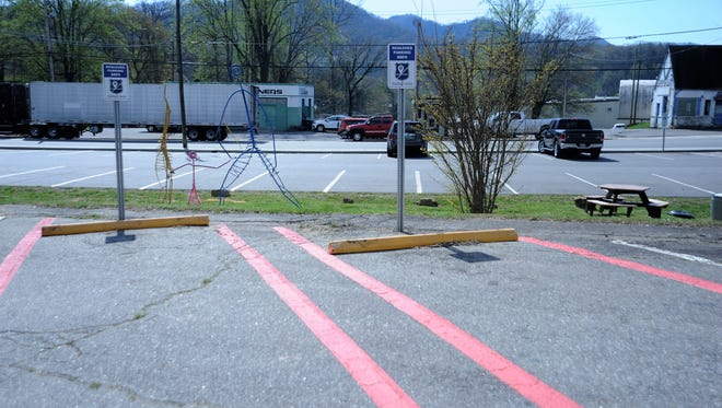 Two parking spaces in front of the Black Mountain Police Department offer a safe location to complete transactions initiated online.